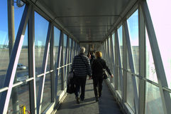 Passengers in airport walkway Stock Images