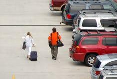 Passengers approaching airport. Airport parking garage, departing passengers Stock Photos