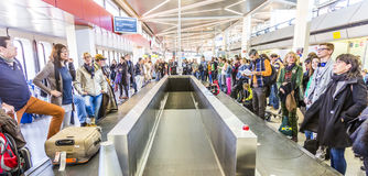 Passengers at the Baggage Carousel at the Airport Tegel Stock Image
