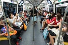 Passengers in Bangkok's skystrain Royalty Free Stock Photography