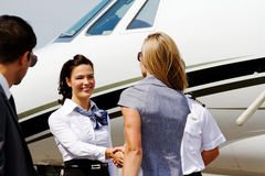 Passengers Being Greeted By Flight Crew Stock Image