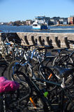 Passengers bicycles parked against a backdrop of the passenger ferry in the harbour. Gothenburg Sweden. Royalty Free Stock Photo