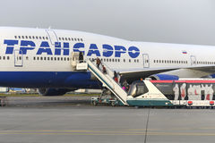 Passengers board the aircraft Boeing 747 Transaero airlines Stock Photo