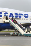 Passengers board the aircraft Boeing 747 Transaero airlines Stock Photos