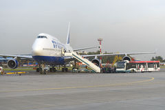 Passengers board the aircraft Boeing 747 Transaero airlines Royalty Free Stock Image
