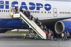 Passengers board the aircraft Boeing 747 Transaero airlines Stock Images
