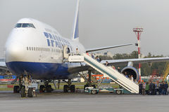 Passengers board the aircraft Boeing 747 Transaero airlines Royalty Free Stock Images