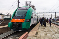 Passengers board a diesel train of the Belarusian railway PESA 7. Passengers board a diesel train of the Belorussian railway PESA 730M DP3 at the Smolevichi Royalty Free Stock Photos