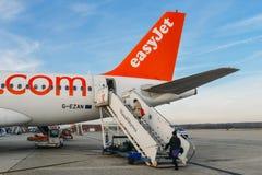 Passengers board an Easyjet Airbus A320 airplanes at Milan Malpensa airport, servicing short-haul flights in Europe. Milan Malpensa, Italy - November 21st, 2017 Stock Photography
