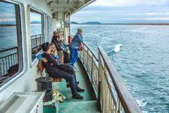 Passengers on a board of the ferry are shipped from the Asian part of Istanbul to the European. ISTANBUL, TURKEY: Passengers on a board of the ferry are shipped royalty free stock photo