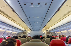Passengers on board flight of commercial aircraft Stock Photos