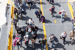 Passengers board the ship at the port of Paros in Greece. Royalty Free Stock Images