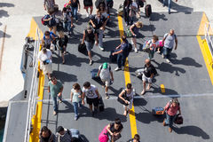 Passengers board the ship at the port of Paros in Greece. Stock Photo