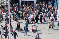Passengers board the ship at the port of Paros in Greece. Royalty Free Stock Photography