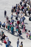 Passengers board the ship at the port of Paros in Greece. Royalty Free Stock Photo