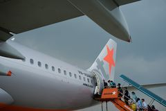 Passengers boarding an aircraft A 320. Jetstar Pacific airplane on runway at Noi Bai airport in Hanoi, Vietnam -  airport staff the plane Royalty Free Stock Photos