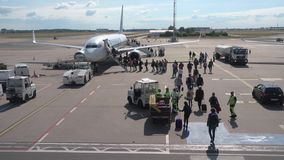 Passengers boarding on the aircraft of low cost airline company Ryanair stock video footage