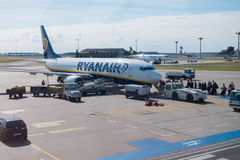 Passengers boarding on the aircraft of low cost airline company Ryanair Royalty Free Stock Image