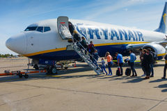 Passengers boarding on the aircraft of low cost airline company Ryanair Royalty Free Stock Photo