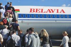 Passengers boarding airplane Royalty Free Stock Image
