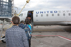 Passengers boarding an airplane Stock Images