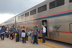Passengers boarding an Amtrak train. ALBUQUERQUE, NEW MEXICO - OCTOBER 9 2016: Passengers wait to present their tickets for boarding the Southwest Chief Amtrak stock images