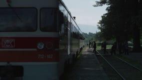 Passengers boarding atrain. A video shot of some passengers boarding an old red and white train stock video