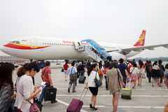 Passengers boarding in Beijing airport Royalty Free Stock Images
