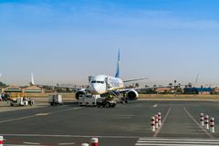 Passengers boarding a Boeing 737 of Ryanair on the platform of the new Marrakech airport royalty free stock photo