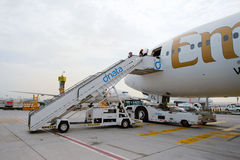 Passengers boarding the Emirates Boeing 777-300ER Royalty Free Stock Photo