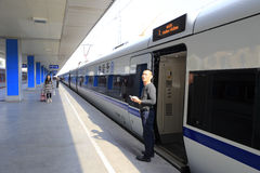 Passengers boarding highspeed train Stock Photo