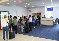 Passengers boarding JetBlue flight to Havana, Cuba at JetBlue Terminal 5 at John F Kennedy International Airport in New York Stock Photography
