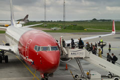 Passengers boarding Norwegian airplane Stock Photography