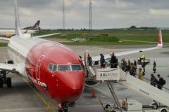 Passengers boarding Norwegian airplane. Passengers getting aboard an airplane from Norwegian airlines Stock Photography