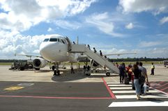 Passengers boarding a Plane. Passengers walking and boarding a Plane Stock Photo
