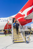 Passengers boarding the Qantas aircraft at Melbourne Airport Royalty Free Stock Photo