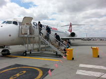 Passengers  Boarding qantas plane at Perth airport Stock Photos