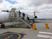 Passengers  Boarding qantas plane at Perth airport Stock Photos