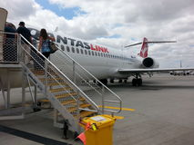 Passengers  Boarding qantas plane at Perth airport Royalty Free Stock Photo