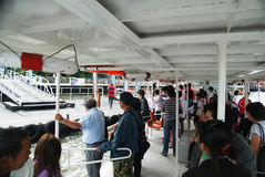 Passengers boarding on river Royalty Free Stock Images