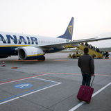 Passengers boarding ryanair airplane on eindhoven airport in the Stock Image
