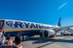 Passengers boarding Ryanair Jet airplane in Palermo airport, Italy Stock Image