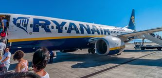 Passengers boarding Ryanair Jet airplane in Palermo airport, Italy Stock Photos