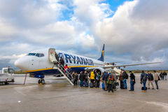 Passengers boarding Ryanair Jet airplane Royalty Free Stock Images