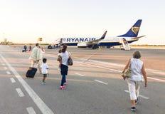 Passengers boarding Ryanair Jet airplane. Royalty Free Stock Photo