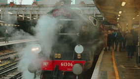 Passengers Boarding a Steam Train at Victoria Station in London. A group of passengers boarding a steam train in Victoria station, London, UK stock footage