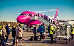 Passengers boarding Stock Photography