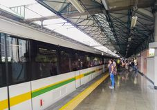 Passengers boarding a train of the Medellin Metro at Industrial station stock photo