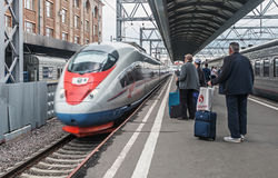 Passengers boarding the train sapsan at the Moscow station Royalty Free Stock Photo