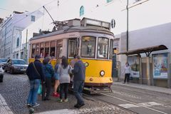 Passengers boarding the tram stop Royalty Free Stock Photo